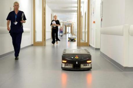robot delivers food in hospital ward