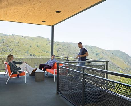 Modern balcony deck with wooden ceiling and metal fence