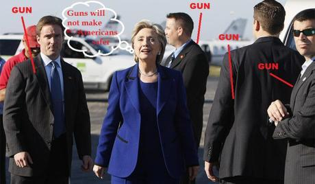 Gun-control Hillary Clinton surrounded by armed Secret Service agents