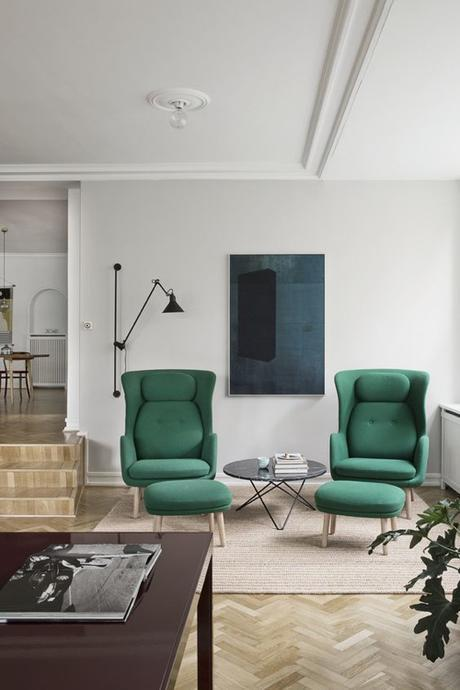 Modern Green Chairs In Sunken Living Room With Herringbone Floors