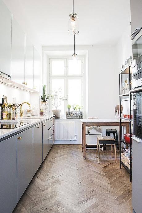 Kitchen In Stockholm Apartment With Grey Cabinets & Brass Faucet