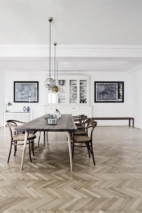 Neutral Modern Dining Room With Herringbone Wood Flooring nd Gallery Wall