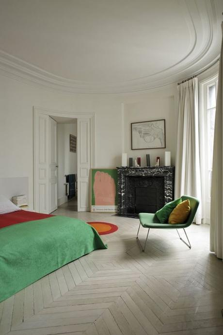 Bedroom With Pale Wood Floor & Green Accents