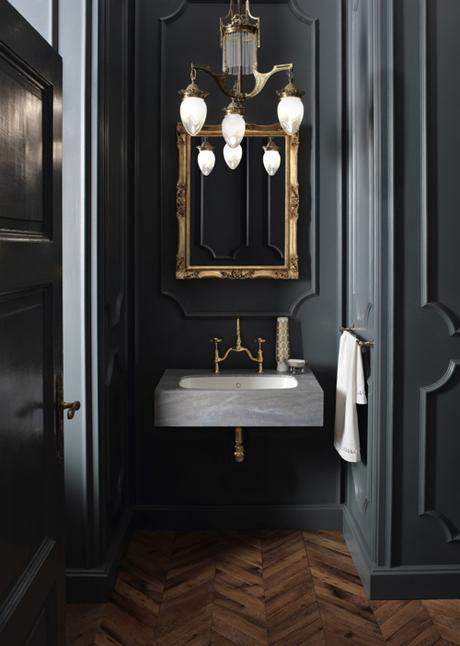 Black Powder Room With Gold Accents