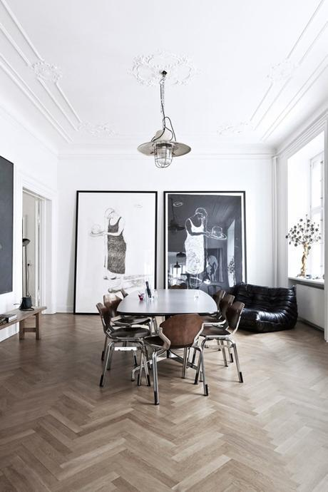 Parisian DIning Room With Statement Photographs And Herringbone Flooring