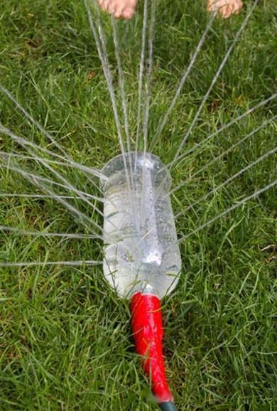 Empty Plastic Pop Bottle Transformed Into A Garden Sprinkler