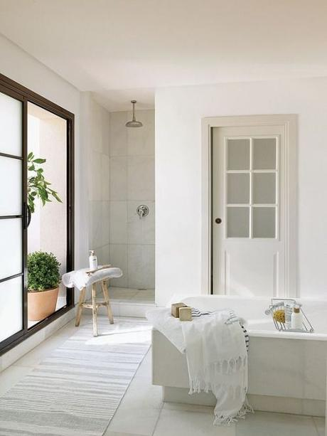 Beautiful white and minimalist bathroom. Walk in shower and a huge bath!: