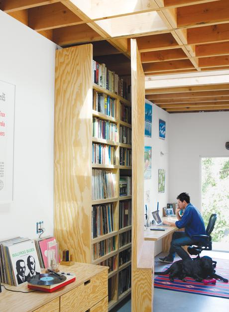 Tall door that swings open to reveal home office