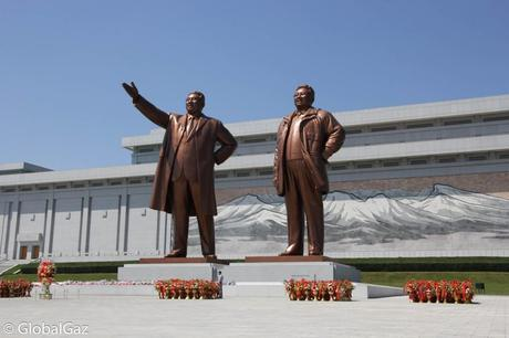 The former leaders (Kim Jong-il and Kim Il-sung) of North Korea greet visitors to their country.