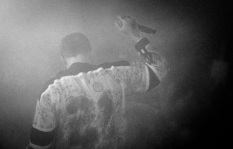 A happy and Yung Lean thanks the crowd hidden in the smoke after the set