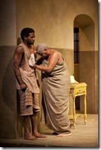 Mai Kuda (Cheryl Lynn Bruce) comforts a distraught Kuda (Warner Miller) in the world-premiere co-production of The Convert by Danai Gurira, directed by Emily Mann.