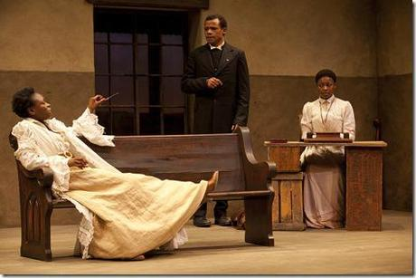 (L to R) Prudence (Zainab Jah) makes a point to Chilford (LeRoy McClain) and Jekesai/Ester (Pascale Armand) in the world-premiere co-production of The Convert by Danai Gurira, directed by Emily Mann.