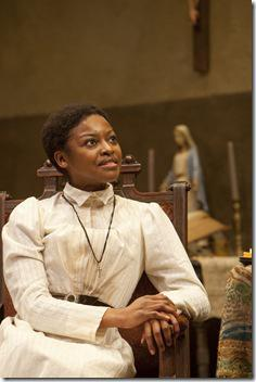 Pascale Armand (Jekesai/Ester) is content with her new life as a Christian in the world-premiere co-production of The Convert by Danai Gurira, directed by Emily Mann.