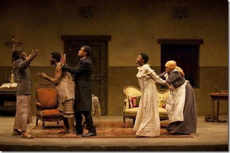 While Chilford (LeRoy McClain) tries to calm Uncle (Harold Surratt) and Kuda (Warner Miller), Mai Kuda (Cheryl Lynn Bruce) holds back Jekesai/Ester (Pascale Armand) during an argument in the world-premiere co-production of The Convert by Danai Gurira, directed by Emily Mann.
