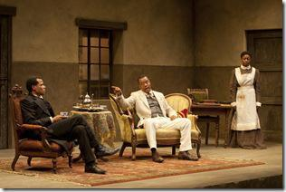 (L to R) Chilford (LeRoy McClain), Chancellor (Kevin Mambo) and Jekesai/Ester (Pascale Armand) rapt in a heated discussion in the world-premiere co-production of The Convert by Danai Gurira, directed by Emily Mann.