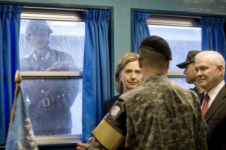 A North Korean Soldier looks in through the window of the T2 building as Secretary of State Hillary Clinton and Defense Secretary Robert M. Gates tour the Demilitarized Zone (DMZ) in Korea, July 21, 2010. Defense Department photo by Cherie Cullen