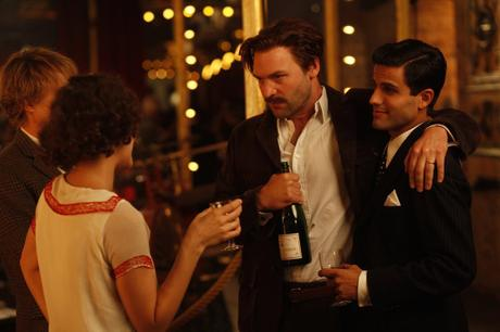 A production image from Midnight in Paris clearly shows Hemingway's striped shirt and vintage Moët bottle.