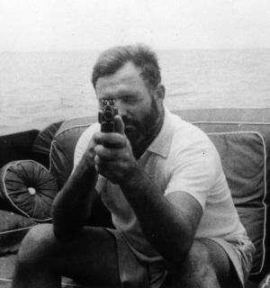 Keep in mind that Hemingway was the type of guy who would go fishing with a Thompson submachine gun, as seen here in 1935.