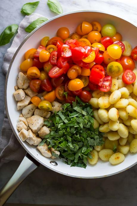 This summery Caprese Chicken Gnocchi Skillet cooks in 30 minutes using one pot, making it a perfect weeknight dinner!