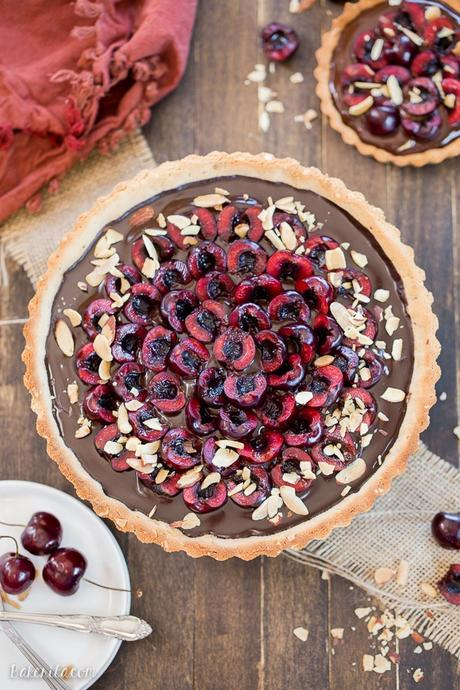 This Chocolate Cherry Tart has a toasted almond shortbread crust filled with silky chocolate ganache and fresh cherries! This gluten-free, Paleo, and vegan dessert is incredibly rich and comes together quickly.