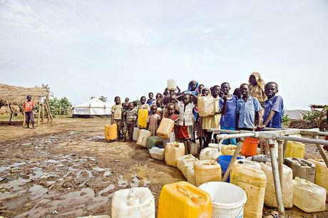 children-and-women-queue-for-the-water-points