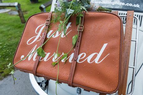 a suitcase with just married written on it