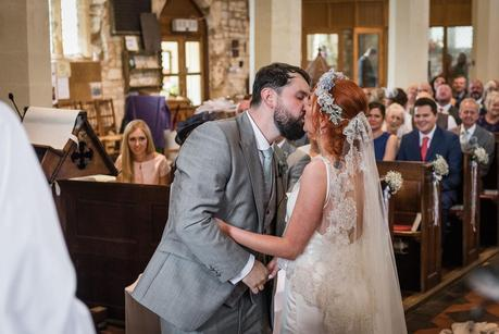a bride and grooms first kiss