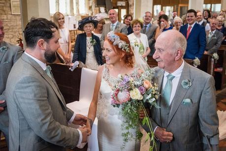bride meeting her husband in church