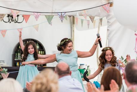 bridesmaid and flower girls dancing