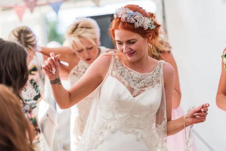 bride having fun on the dancefloor at a rustic wedding