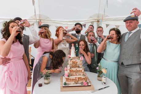 wedding party having a shot of sambuca