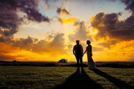 bride and groom in the sunset on a rustic wedding