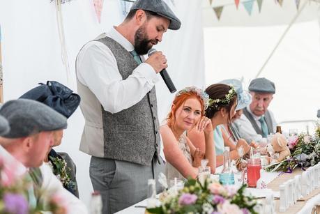 a bride listening to her husbands wedding speech