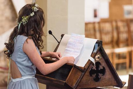 flower girl giving a reading
