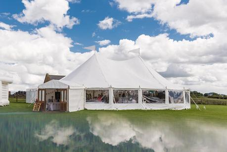 wedding marquee with clouds reflection