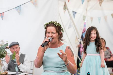 bridesmaid singing at a summer wedding