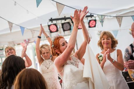 bride clapping on the dancefloor at a wedding