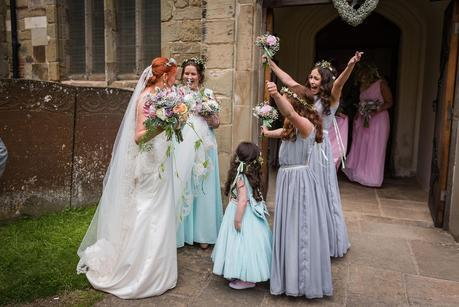 Flower girl with arms in air outside the church