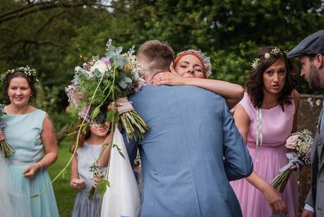 a bride being congratulated outside hillmorton church