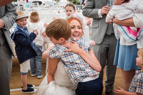 a bride hugging a wedding guest