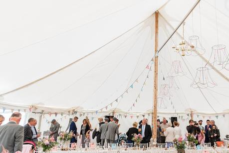 wedding guests in a marquee