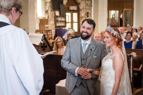 bride and groom smiling after being married
