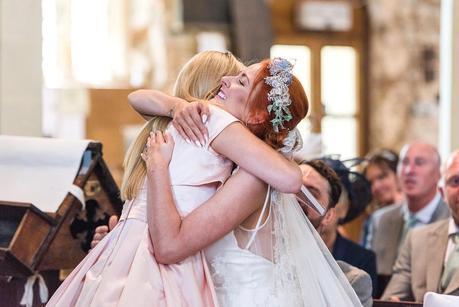bride hugging a wedding guest