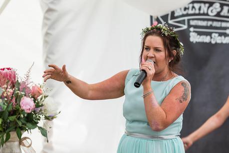 brides sister rapping at a wedding