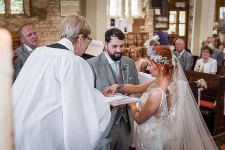 bride picking up her wedding ring