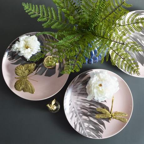 One of our top tips for styling is to use objects such as a tray, or a plate, like this pretty palm leaf plate, to place the objects on. This helps to unify individual objects and create a much more cohesive look.