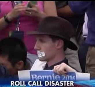 Bernie delegate with mouth taped shut