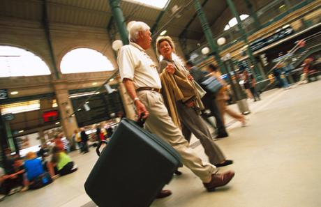 Mature couple in railway station