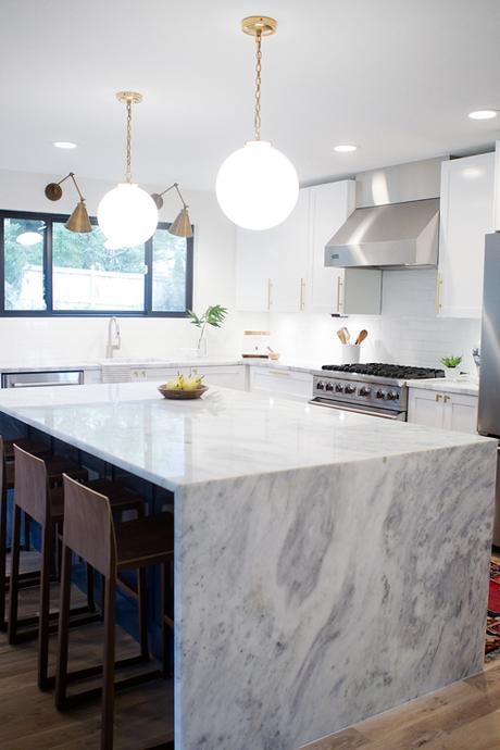 Super White Quartz Counters In Contemporary White Kitchen