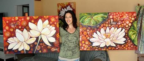 Artist Cedar Lee with Lotus paintings: Dragonfly's Discovery (left) and Resting Place (right)